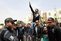 Tunisian police fired tear gas to break up rioting by hundreds of protesters who took to the streets after a fruit seller set himself on fire when police stopped him working, local residents...