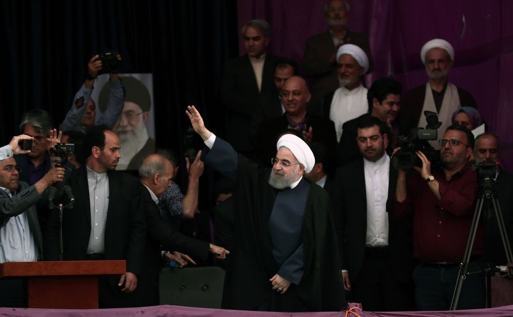 Hassan Rouhani greeting his supporters at a campaign rally ahead of the presidential elections at the Takhti stadium in the northeastern city of Mashhad, May 17.