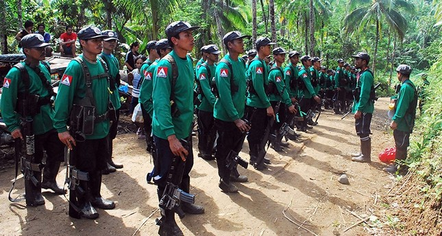 In this file photograph taken on December 26, 2009, New People's Army (NPA) rebels stand to attention during the 41st founding anniversary of the Communist Party of the Philippines in Surigao del Sur province of Mindanao Island. (AFP Photo)