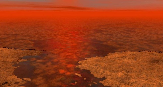 An artist's concept envisions what hydrocarbon ice forming on a liquid hydrocarbon sea on Saturn's moon Titan might look like. (REUTERS Photo)
