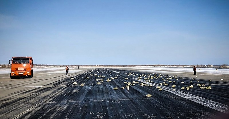 A handout picture provided by YakutiaMedia news agency shows precious metal ingots on the runway of the airport of Yakutsk, Russia, March 15, 2018. (AFP Photo/YakutiaMedia)