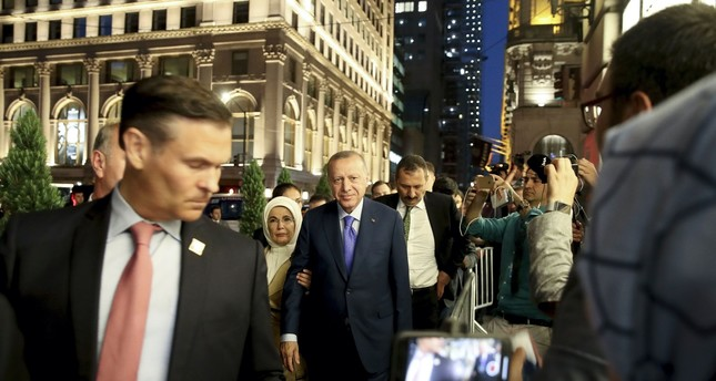 President Recep Tayyip Erdoğan C and his wife, first lady Emine Erdoğan, are welcomed by Turkish people in New York City, where he has arrived in to attend the U.N. General Assembly, Sept. 21, 2019.