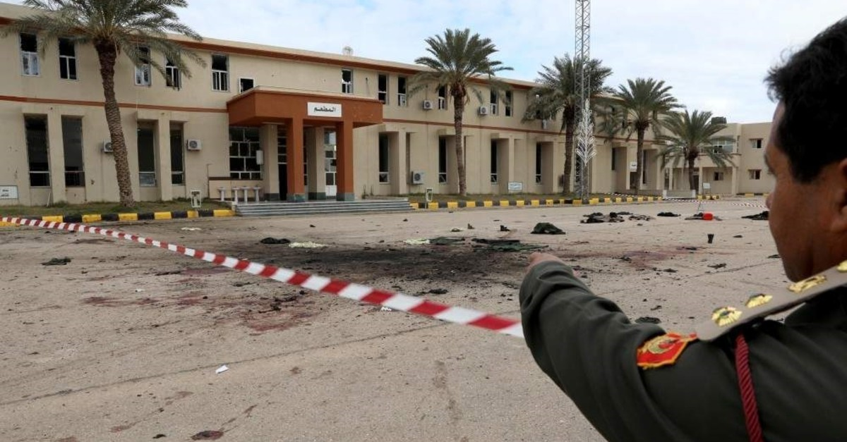 A member of security forcers of the Government of National Accord (GNA) gestures as he inspects the site of an attack on a military academy in Tripoli, Libya Jan. 5, 2020. (REUTERS)