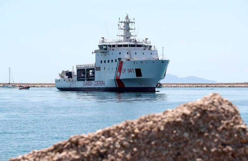 The Diciotti ship of the Italian Coast Guard, with 67 migrants on board rescued 4 days ago by the Vos Thalassa freighter, enters the Sicilian port of Trapani, southern Italy, Thursday, July 12, 2018. (ANSA via AP)