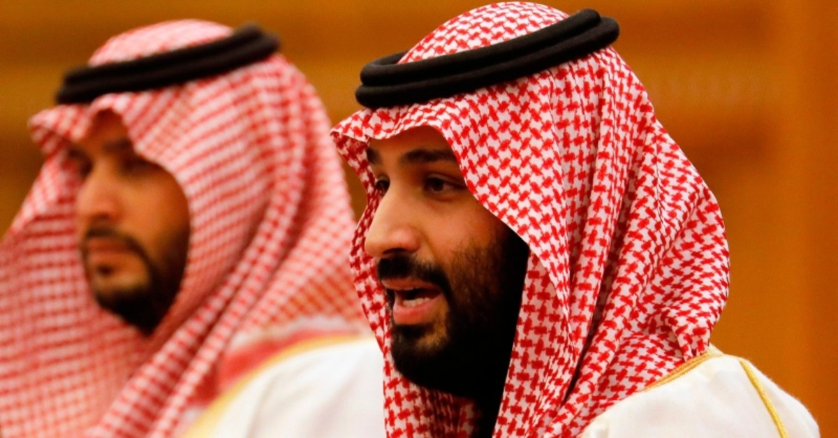 Saudi Crown Prince Mohammed bin Salman (R) attends a meeting with Chinese President Xi Jinping (not pictured) at the Great Hall of the People in Beijing on February 22, 2019. (AFP Photo)