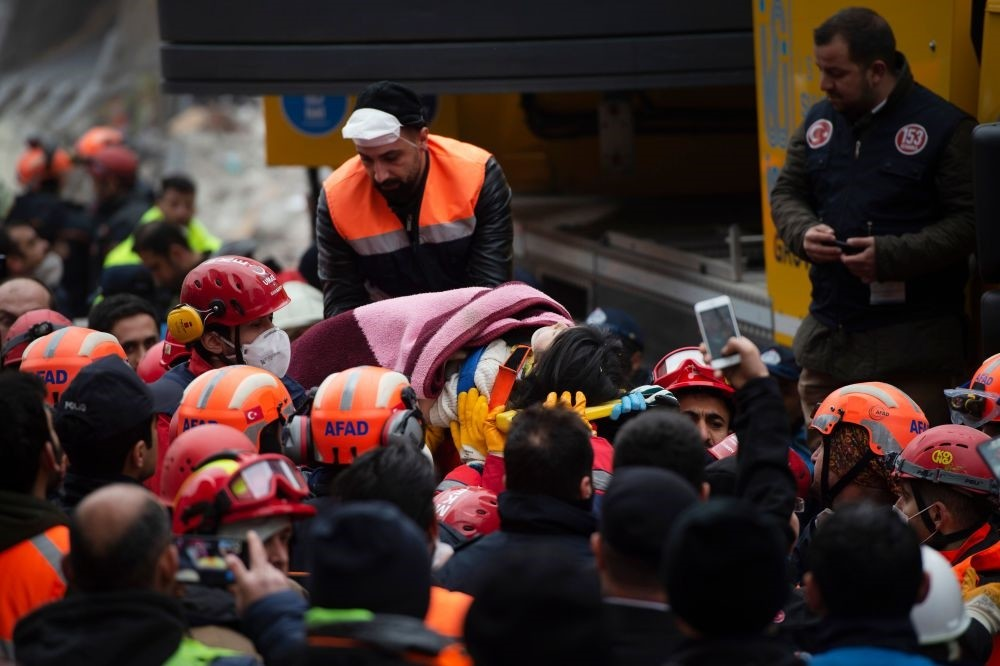 Rescue crews evacuate Havva Tekgu00f6z from the rubble some 19 hours after the collapse in Istanbul's Kartal district on Feb. 7, 2019.