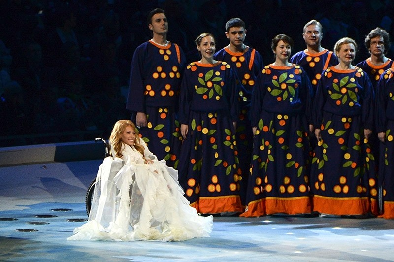 In this Friday, March 7, 2014 file photo, Yulia Samoylova, sits on stage during the opening ceremony of the 2014 Paralympic Games in Sochi, Russia. (AP Photo)