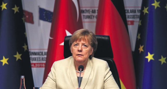 German Chancellor Angela Merkel listens during a joint news conference in Gaziantep, Turkey, following her visit along with top European Union officials, April 23, 2016.