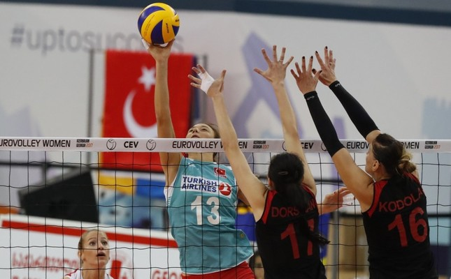 Hatice Gizem Örge (L) and Neriman Özsoy (C) of Turkey in action against Svitlana Dorsman (2-R) and Nadia Kodola (R) of Ukraine during the 2017 CEV Volleyball Women European Championship match.