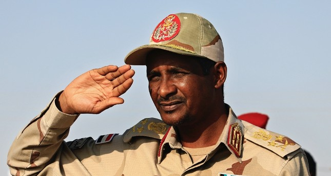 Gen. Mohammed Hamdan Dagalo salutes supporters during a rally, Galawee, June 15, 2019.