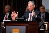 Fed chairman says US economy healthy, hints at slower rate hikes