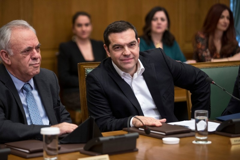 Greek Prime Minister Alexis Tsipras (R) and ministers of his government attend a cabinet meeting in the parliament in Athens, in Athens, on Monday, Jan. 28, 2019. (AP Photo)