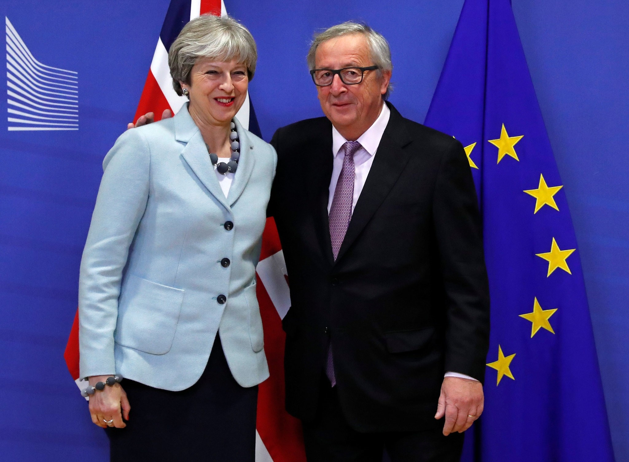 Britain's Prime Minister Theresa May is welcomed by European Commission President Jean-Claude Juncker at the EC headquarters in Brussels, Belgium December 8, 2017.  (REUTERS Photo)