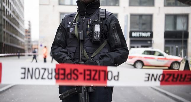 Special police secure an area in Zurich, Switzerland, Friday, Feb. 23, 2018 after a shooting in front of a bank (AP Photo)