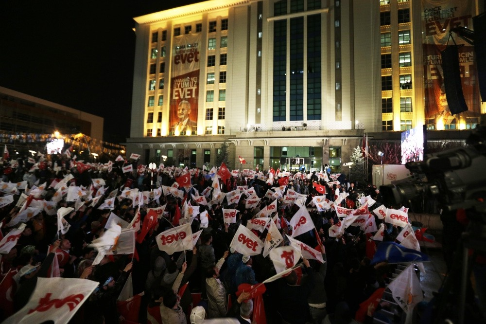 Turkish people waving 'yes' flags to celebrate the referendum victory of the 'yes' campaign on Sunday in Ankara, April 16.