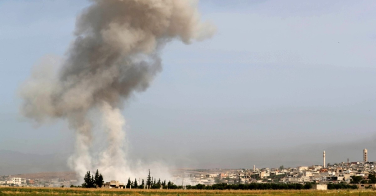 Smoke plumes billow following reported Assad regime forces' bombardment in the southern countryside of the largely opposition-controlled region of Idlib on May 24, 2019. (AFP Photo)