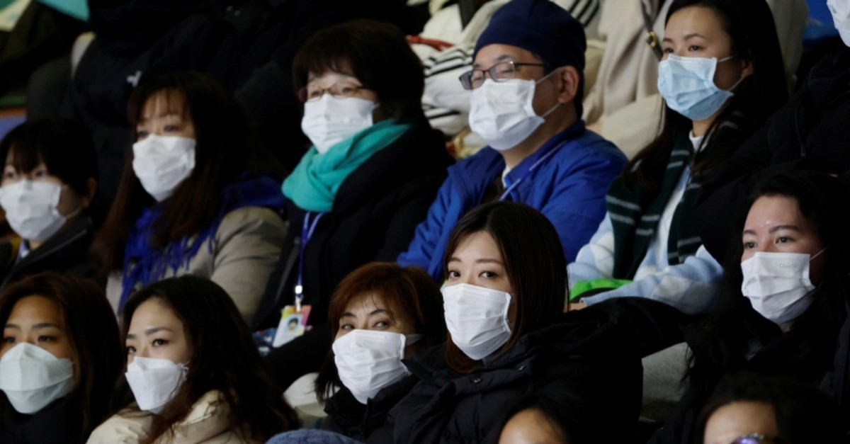 Spectators wearing masks to prevent contacting to a new coronavirus attend Four Continents Figure Skating Championships 2020 in Seoul, South Korea, February 7, 2020. (Reuters Photo)
