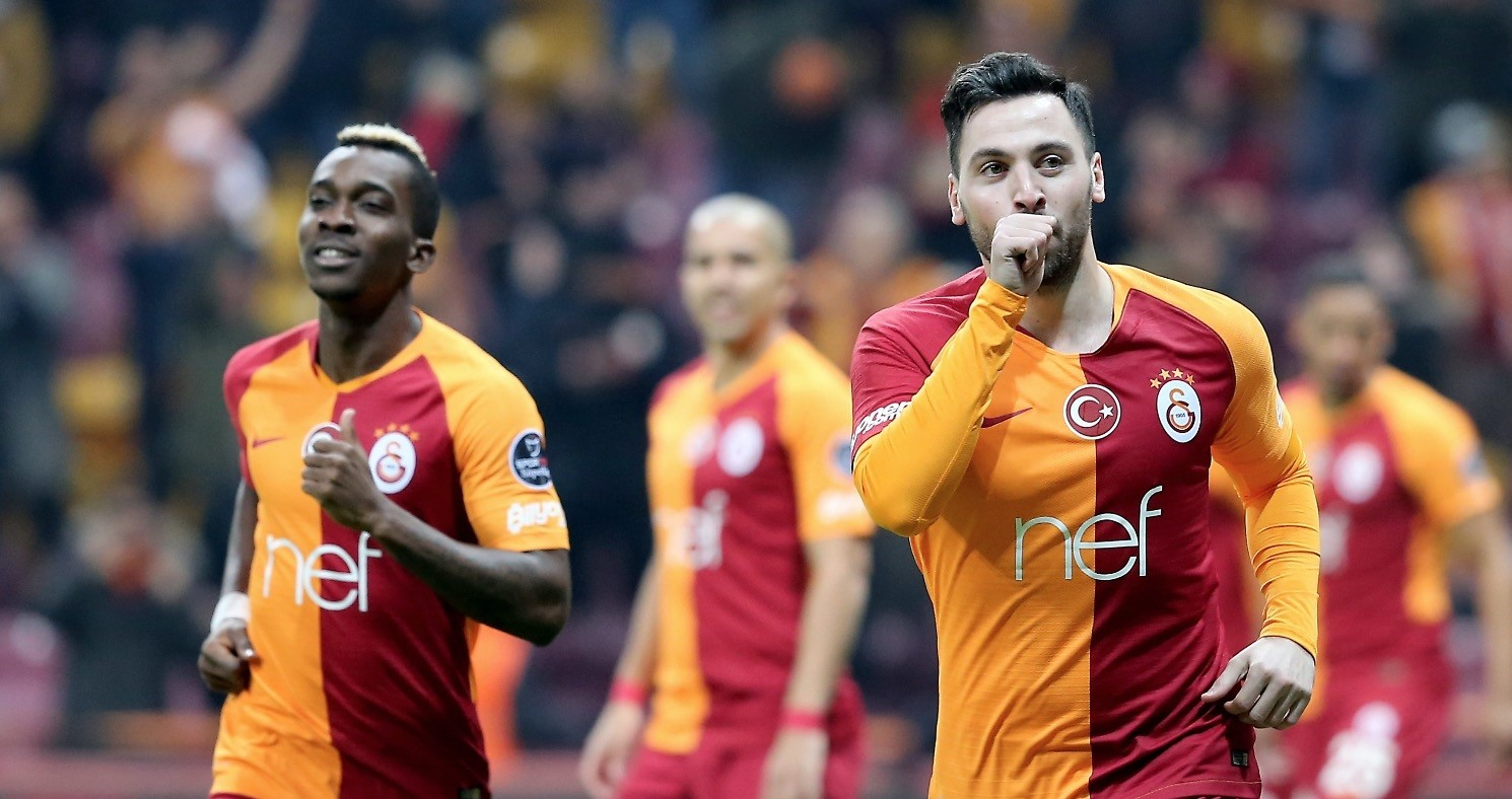Galatasarayu2019s Sinan Gu00fcmu00fcu015f, right, celebrates after scoring one of his two goals with teammate Onyekuru, Jan. 19, 2019.