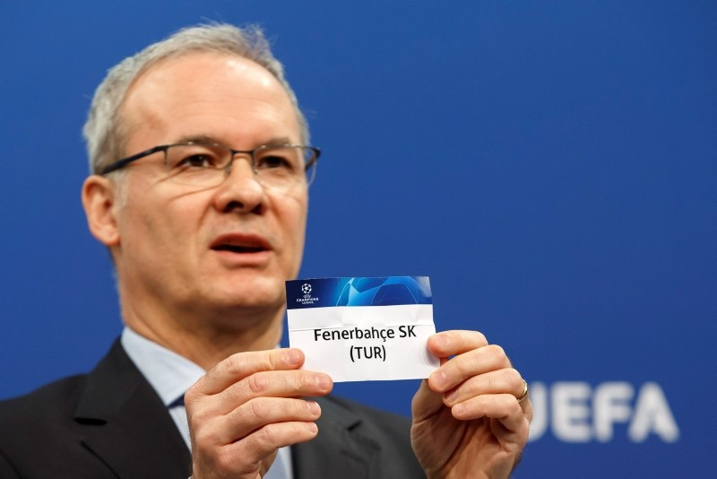 UEFA Deputy Secretary-General Giorgio Marchetti shows a ticket of Fenerbahu00e7e during the drawing of the fixtures for the Champions League 2018/19 third qualifying round at the UEFA headquarters in Nyon, Switzerland, July 23, 2018. (AFP Photo)