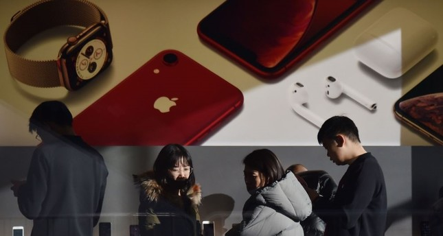Customers look at products in an Apple store in Beijing, Dec. 11.
