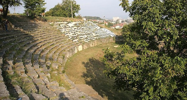 The ancient theater includes a semicircular seating area known as the 40 Steps.