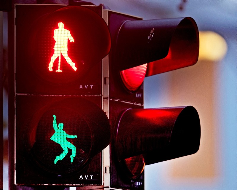 Walking figures depicting late US rock and roll legend Elvis Presley appear on a traffic light switching from green to red in Friedberg near Frankfurt, Germany, Thursday, Dec. 6, 2018. (AP Photo)