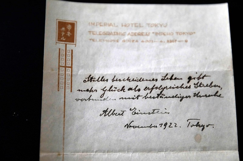 This file photo taken on October 19, 2017 shows a note written by Albert Einstein, in 1922, on hotel stationary from the Imperial Hotel in Tokyo Japan. (AFP Photo)
