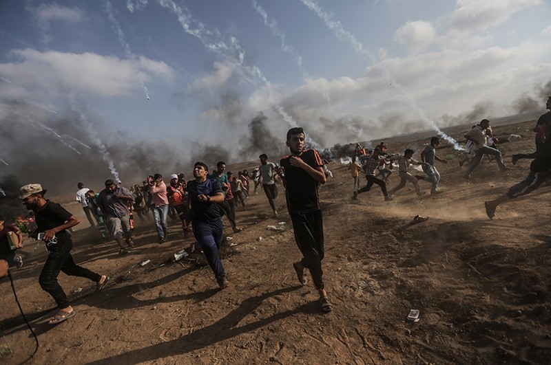 Palestinian demonstrators clash with Israeli forces in northern Gaza Strip, Aug. 3, 2018. (EPA Photo)