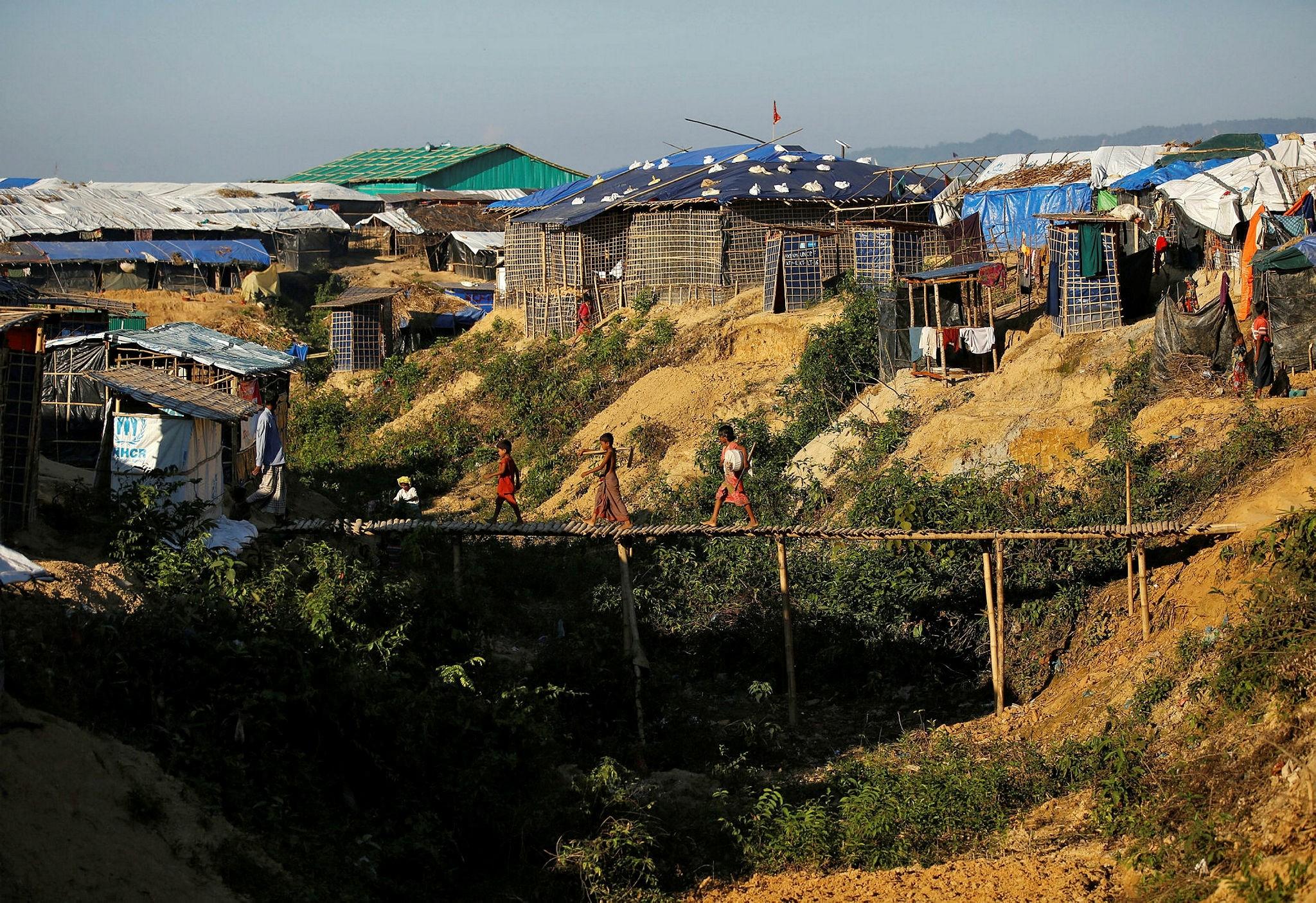 Rohingya refugee children cross a bamboo bridge at the Kutupalong refugee camp near Cox's Bazar, Bangladesh, Nov. 8.