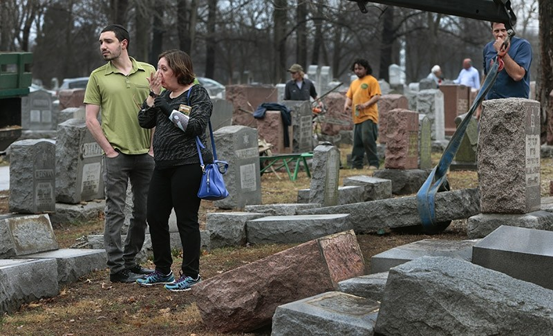 ally Amon and her son Max Amon of Olivette, Mo., react as they saw toppled gravestone of her grandmother Anna Ida Hutkin at Chesed Shel Emeth Cemetery in University City (AP Photo)