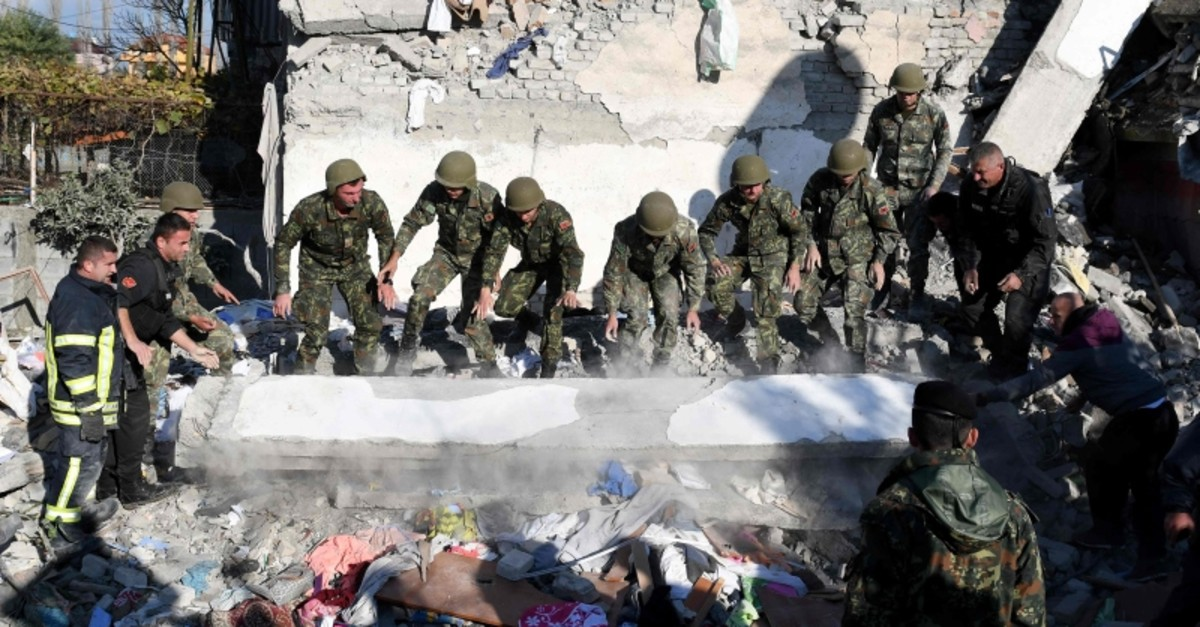 Emergency workers clear debris at a damaged building in Thumane, 34 kilometers (about 20 miles) northwest of capital Tirana, after an earthquake hit Albania, on November 26, 2019. (AFP Photo)