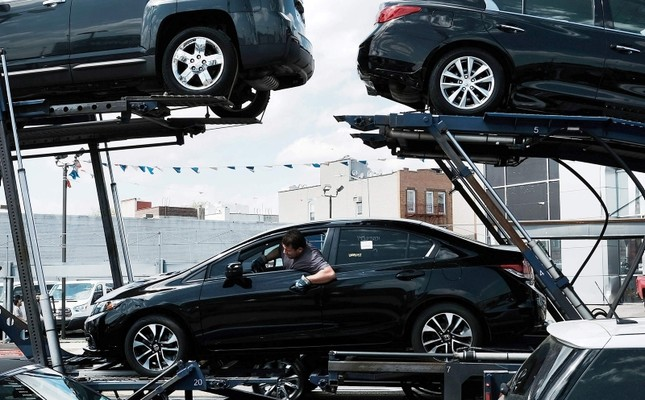 In this file photo taken on May 2, 2017, new cars are delivered to a Queens auto dealership in New York City. (AFP Photo)