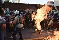 While many dozens have died in recent months amid anti-government protests in Venezuela, the most striking event has been the recent images seen of a man surrounded by protesters and burned alive...