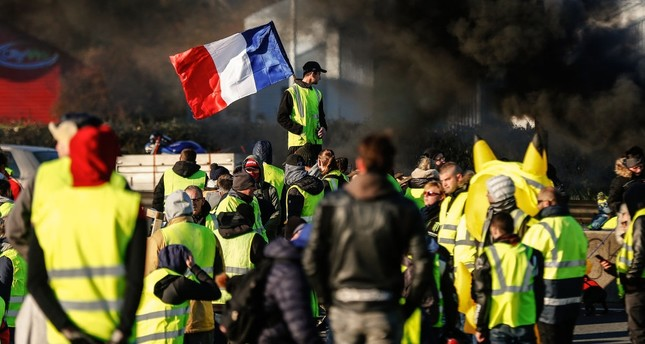 The yellow vests protestors block a road during a demonstration againt the French government, Caen, France, Nov. 18, 2018.
