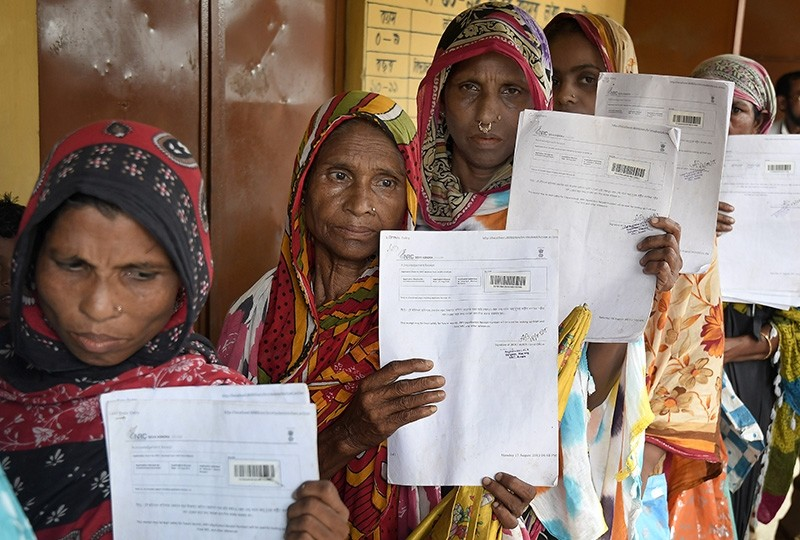 Women wait in queue to verify their names on National Register of Citizens (NRC) draft in Morigaon district of Assam, India, July 30, 2018. (EPA Photo)