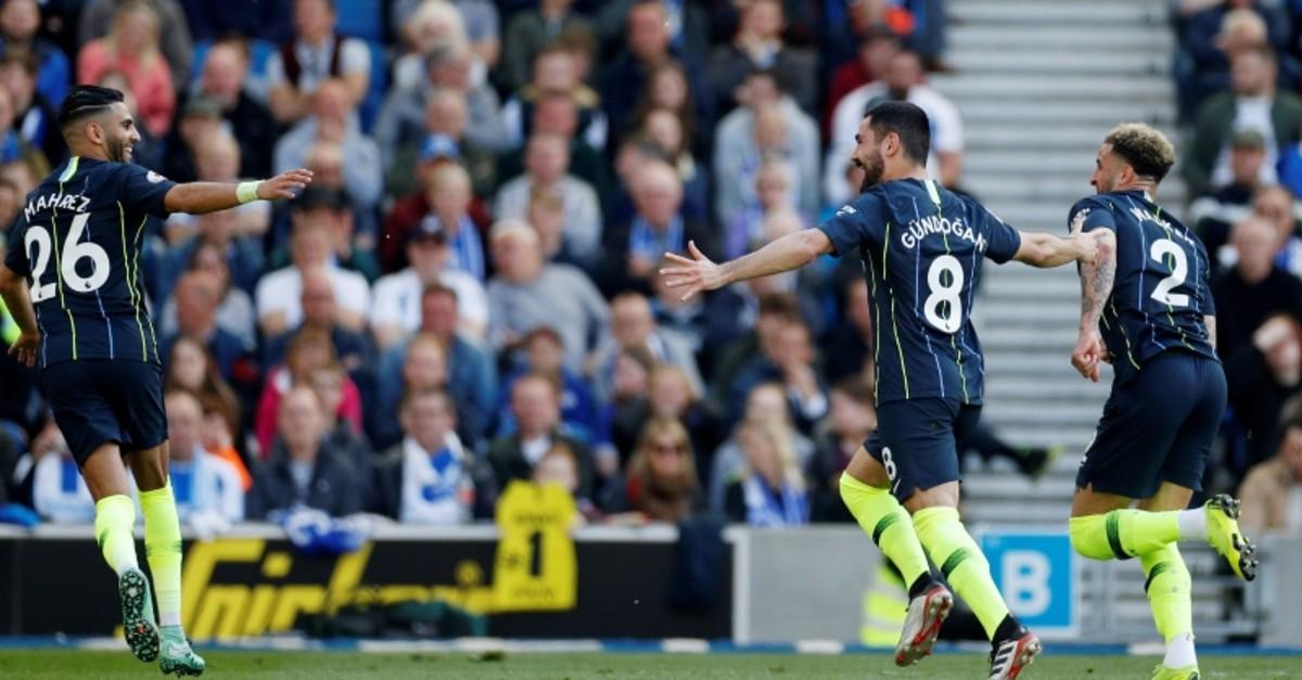 Manchester City's Ilkay Gu00fcndou011fan celebrates scoring their fourth goal with team mates. (Reuters Photo)