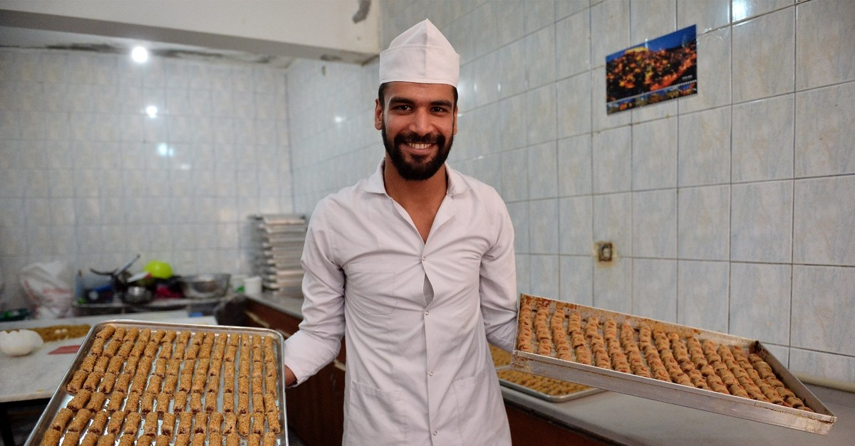 Fadil Al Azzavi displays the Su00fcryani u00c7u00f6reu011fi pastries, which has made him famous in the region for mixing the unique tastes of the region.