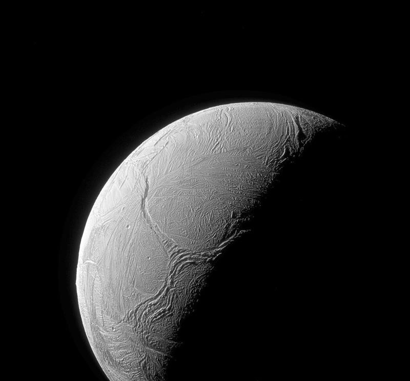 This Feb. 15, 2016 image made available by NASA shows cracks in Enceladus' icy shell caused by tectonic stresses, as seen from the Cassini spacecraft.