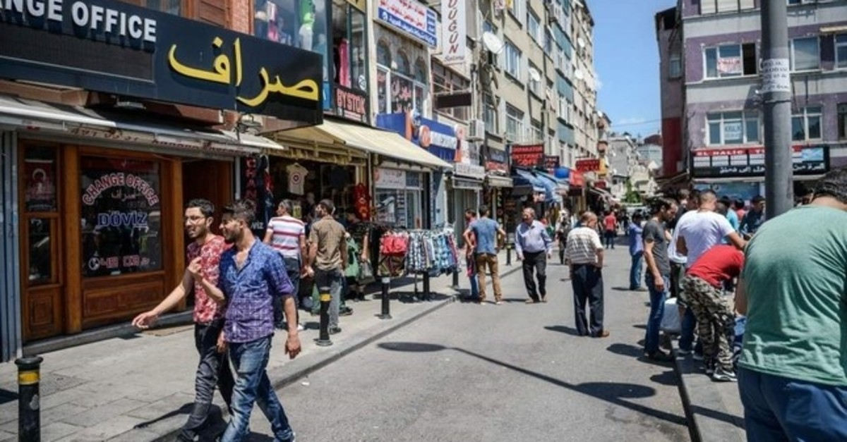 Syrian and Turkish people walk in a street next to shops with Arabic letters in Fatih district, Istanbul in this undated photo. (AFP Photo)