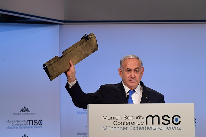Israeli Prime Minister Benjamin Netanyahu holds out what he calls ,a piece of an Iranian drone, Israel shot down during his speech at the Munich Security Conference in Munich, Germany, Feb. 18, 2018. (Facebook/The Prime Minister of Israel)