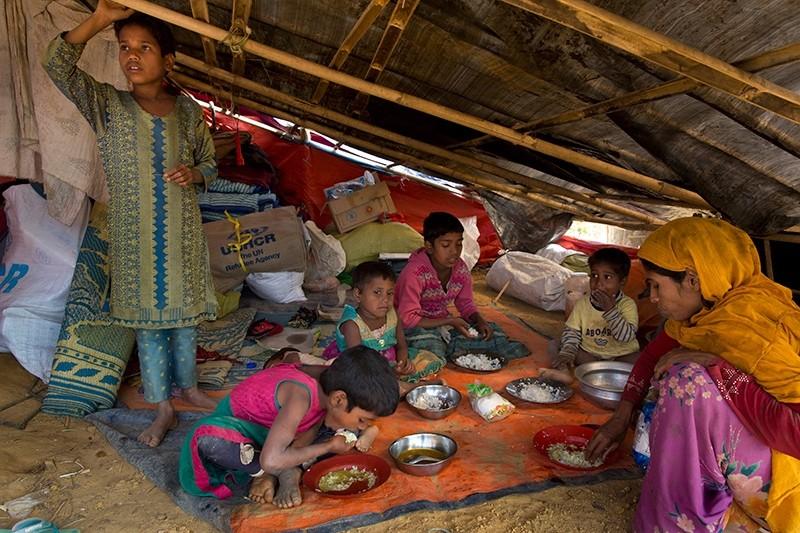 In this Saturday, Jan. 13, 2018, photo, a newly arrived Rohingya family eats at the Balukhali refugee camp near Cox's Bazar, Bangladesh. (AP Photo)