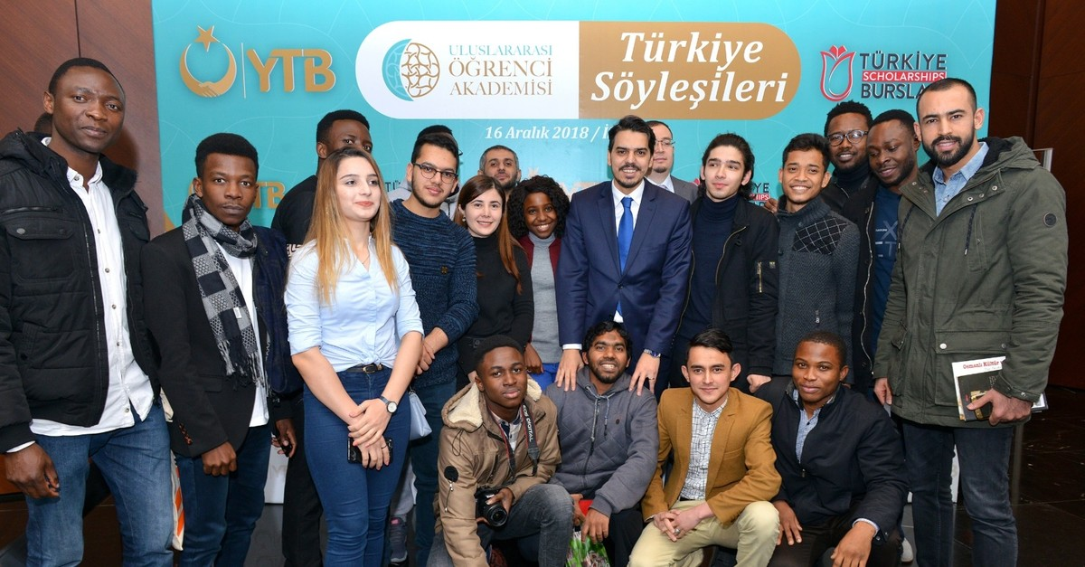 YTB chairman Abdullah Eren poses with international students in Turkey at an event, Istanbul, Dec. 16, 2018. (COURTESY OF YTB)