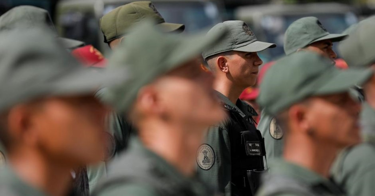 Soldiers stand in formation before the start of a ceremony to kick off the distribution of security forcers and voting materials to be used in the upcoming presidential elections, in Caracas, Venezuela May 15, 2018. (Reuters Photo)