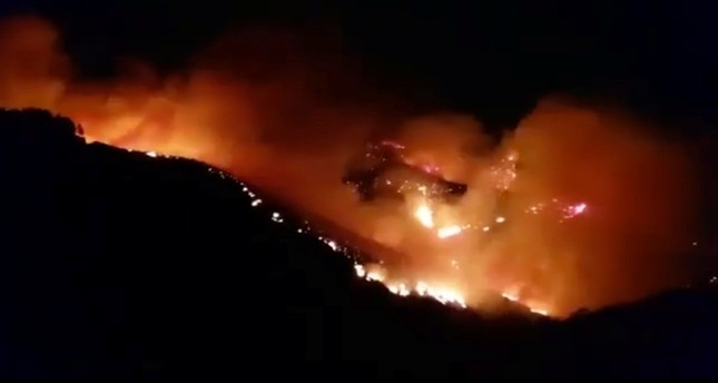 A wildfire burns in this still image obtained from social media video between Juncalillo and Pinos de Galdar, on Gran Canaria, Canary Islands, Spain in the early hours of August 11, 2019. Reuters Photo