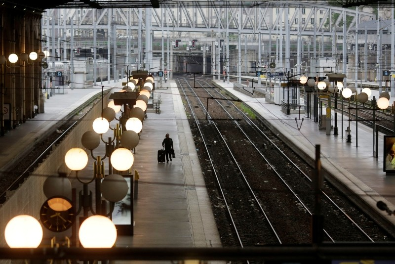 A man walks over a platforms during a railway strike at the Gare du Nord train station, in Paris, Thursday, June 2, 2016. (AP Photo)