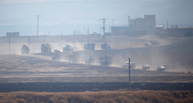 Turkish and Russian military vehicles are seen during a joint patrol in northeast Syria, Nov. 1, 2019. (Reuters Photo)