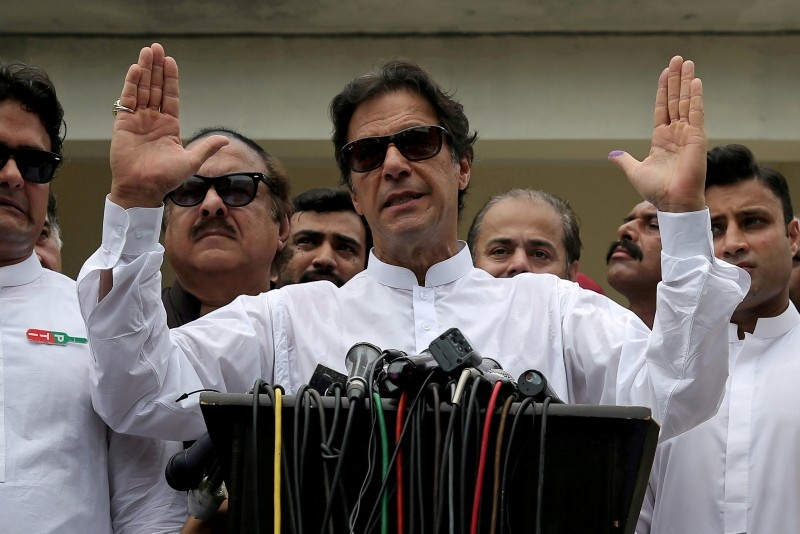 Cricket star-turned-politician Imran Khan, chairman of Pakistan Tehreek-e-Insaf (PTI), speaks after voting in the general election in Islamabad, July 25, 2018. (Reuters Photo)