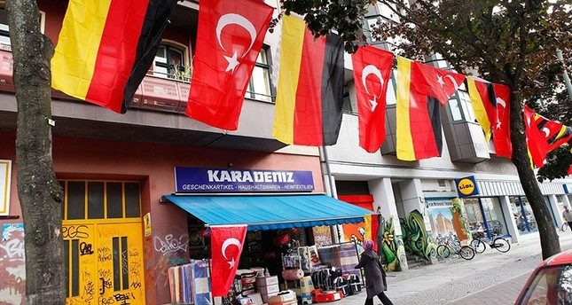 A shopkeeper in Kreuzberg, a district with a large Turkish population, has German and Turkish flags outside his shop (File Photo