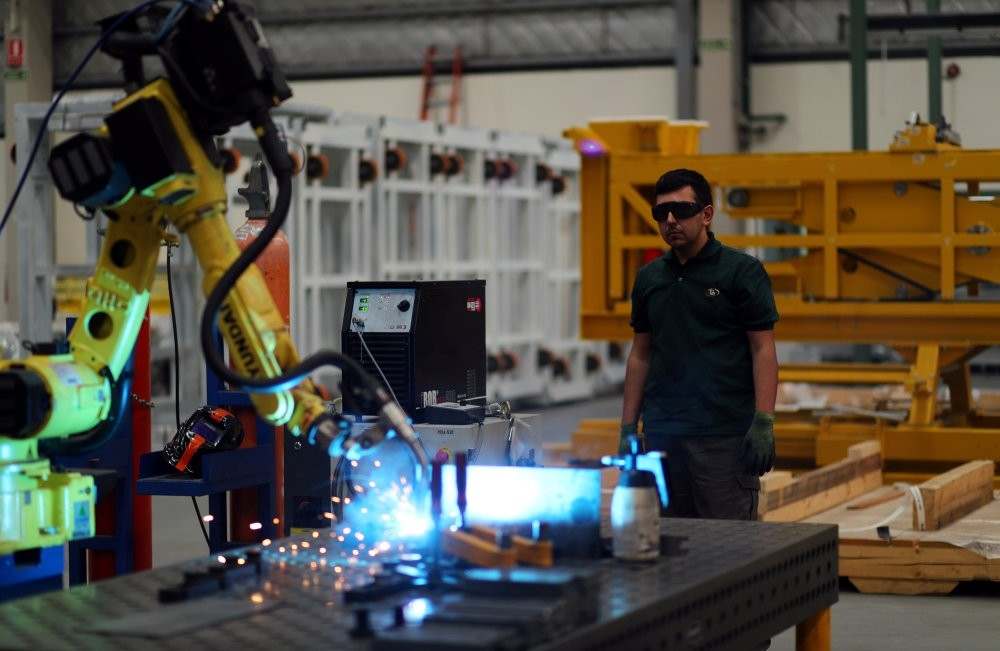 An employee stands as he operates a machine at industrial manufacturing company Gottert in Garin, on the outskirts of Buenos Aires, Argentina, Nov. 1, 2018.