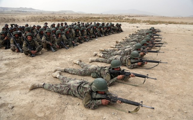 In this Oct. 31, 2018, photo, Afghan National Army (ANA) soldiers carry out an exercise during a live firing at the Afghan Military Academy in Kabul, Afghanistan. (AP Photo)